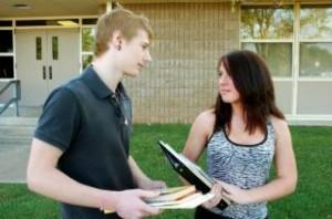 two-teenagers-talking_19-127757
